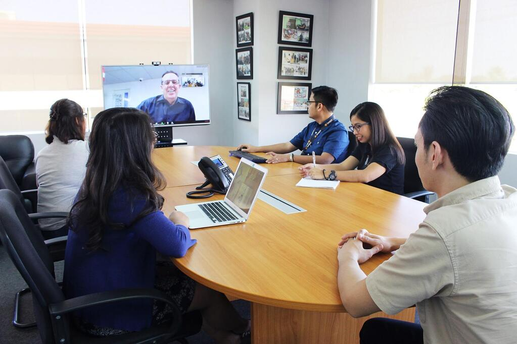 Create a professional video conferencing setup to meet with your real estate virtual assistant